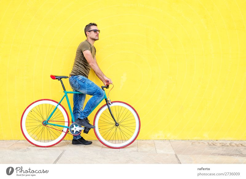 Side view of a young hipster man with a fixed bike Human being Masculine Young man Youth (Young adults) Man Adults 1 18 - 30 years 30 - 45 years Clothing