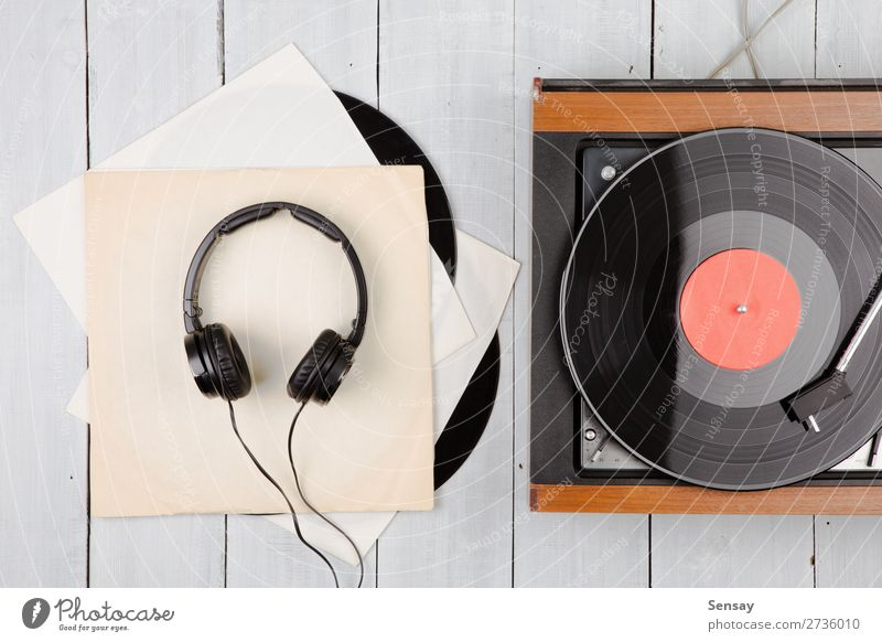 Vintage turntable and headphones Plate Playing Entertainment Music Disc jockey Technology Wood Old Retro Black White Turntable record vintage Player vinyl Sound