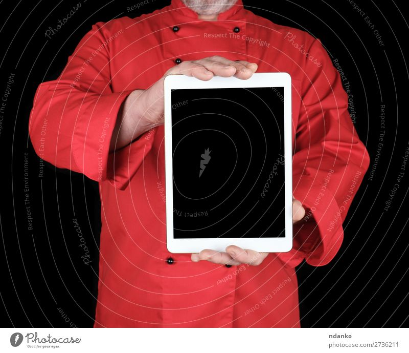 chef in a red uniform holding a white electronic tablet Cook Business Computer Notebook Screen Technology Internet Human being Man Adults Hand Shirt Stand Red