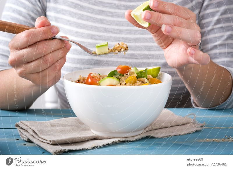 Woman eating quinoa and vegetables in bowl Vegan diet Vegetable Tomato Bowl Vegetarian diet Healthy Healthy Eating Diet Grain Preparation superfood Seed gluten