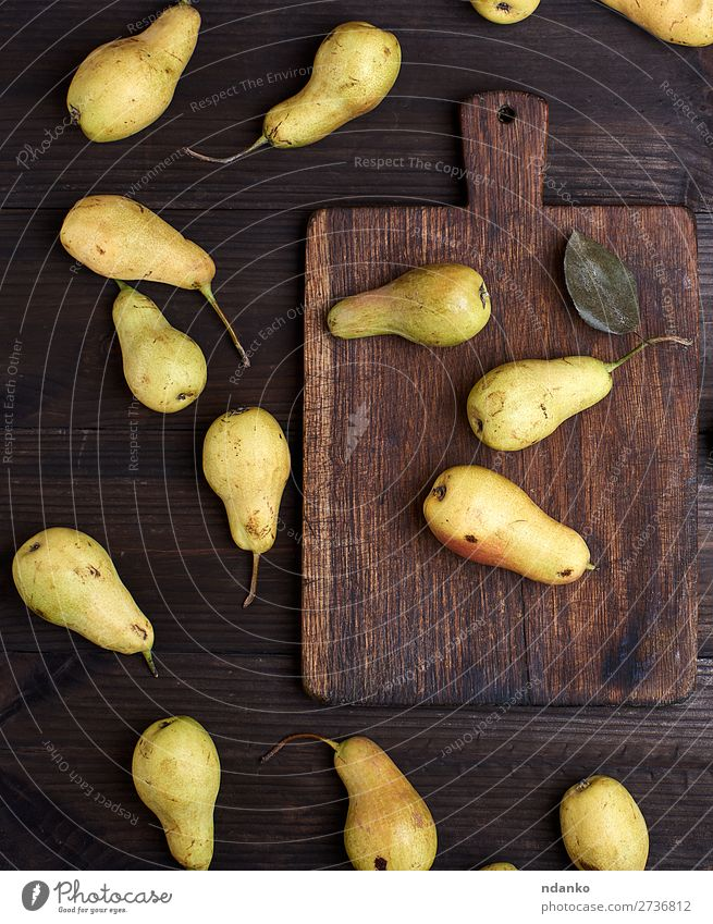 fresh ripe yellow pears on a brown wooden table Fruit Nutrition Vegetarian diet Diet Table Group Nature Wood Old Eating Fresh Delicious Natural Above Juicy