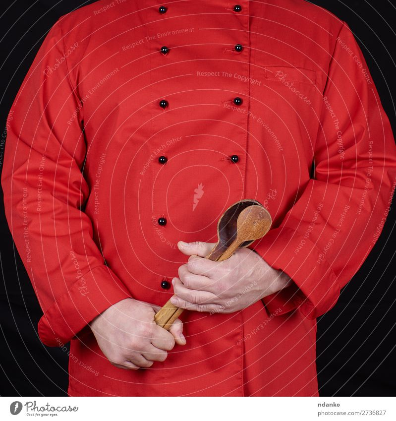 chef in red uniform holding old wooden spoons Spoon Kitchen Restaurant Profession Cook Human being Man Adults Hand Wood Stand Red Black Caucasian chopping