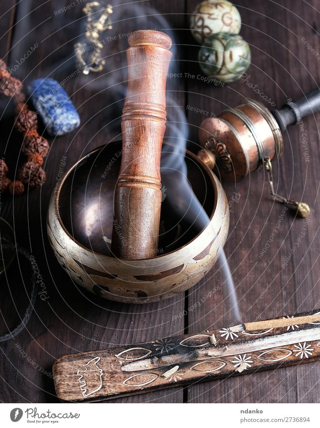 copper singing bowl and a wooden stick Lifestyle Medical treatment Alternative medicine Wellness Relaxation Meditation Table Music Yoga Culture Candle Wood