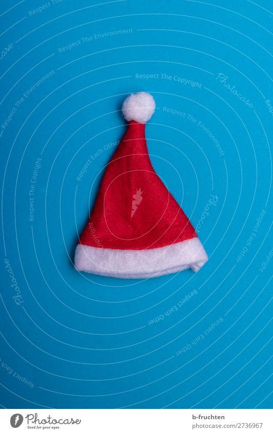 Christmas hat on blue background Feasts & Celebrations Christmas & Advent Cap Paper Decoration Utilize Lie Crazy Blue Red Santa Claus Santa Claus hat Dress up