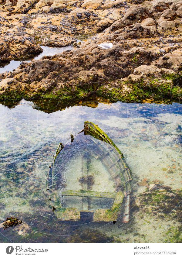Sunken wooden boat in the sea Ocean Sky Coast Watercraft Wood Old Blue background Deep fish fishing float marine Shipwreck Sink Go under sunken vessel water