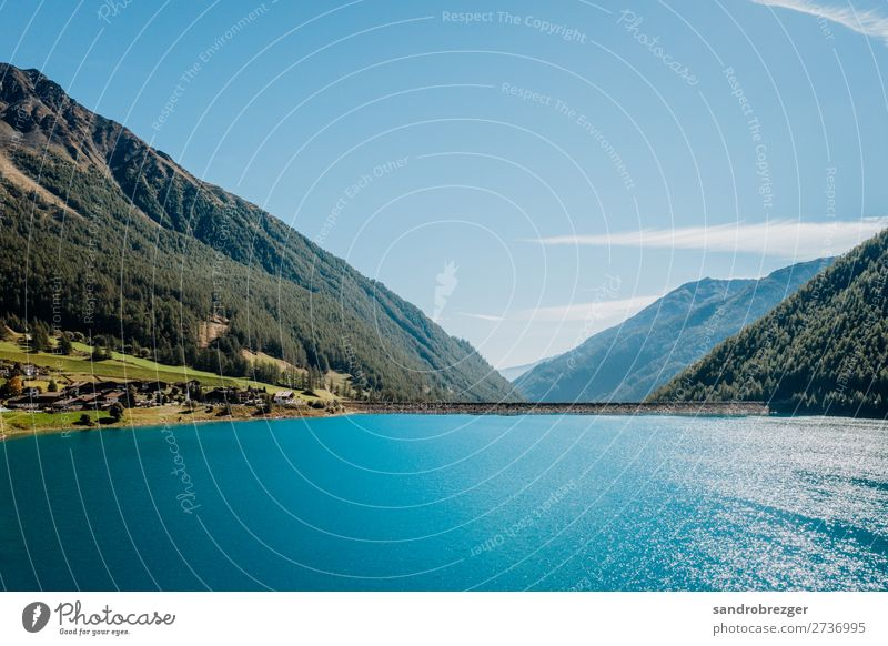 Postponed Reservoir in autumn South Tyrol reservoir Lake Blue mountains Nature pure nature Blue sky Water Mountain Sky Exterior shot Landscape Alps Colour photo