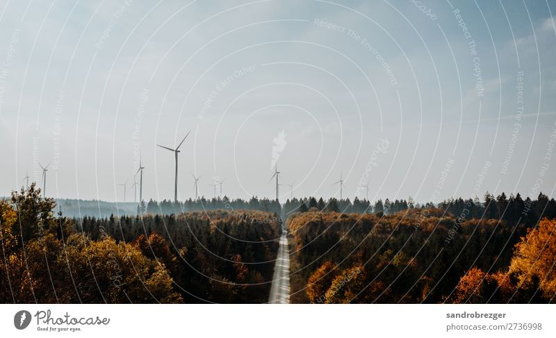 Wind turbines in the autumn forest Pinwheel windmills eco-power stream Energy Forest Autumn Air Street off warm Sky