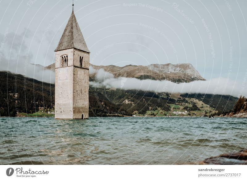 Church in water - Reschensee Resia Water Lake Reschen reschenpass Alps South tyrolian south Tyrol Clouds mountains Church spire bells Drown Belief