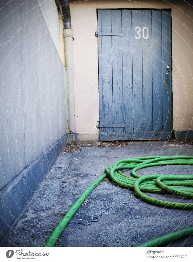 Green Wall (building) Wall (barrier) Work and employment Door Characters Perspective Floor covering Digits and numbers Asphalt 30 Backyard Hose Rain gutter Wooden door Garden hose