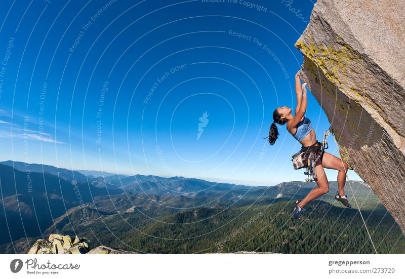 Rock climber dangling. Fitness Life Adventure Climbing Mountaineering Success Feminine Woman Adults 1 Human being 18 - 30 years Youth (Young adults) Peak Hang