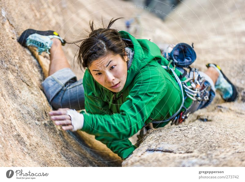 Female climber clinging to a cliff. Life Adventure Climbing Mountaineering Rope Feminine Young woman Youth (Young adults) 1 Human being 18 - 30 years Adults