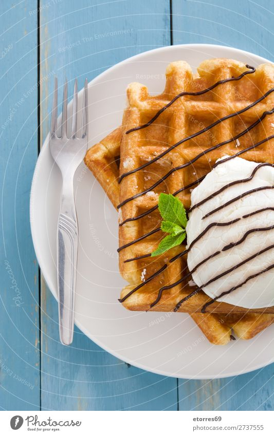 Belgian waffles with ice cream on blue wooden table. Waffle Dessert Ice cream Belgium White Sweet Food Healthy Eating Food photograph Neutral Background