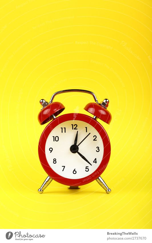 Close up one red alarm clock over yellow background Clock Metal Old Sleep Retro Yellow Red Tradition Clock face bell Twin timing Conceptual design warning Warn