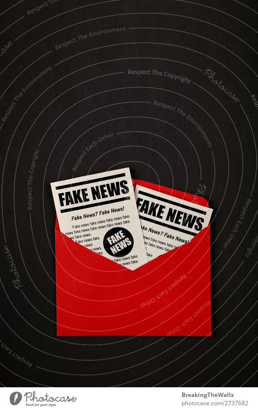Envelope with FAKE NEWS newspapers over black Mail Media Print media New Media Email Newspaper Magazine Paper Red Black False Colour fake Journalism issue