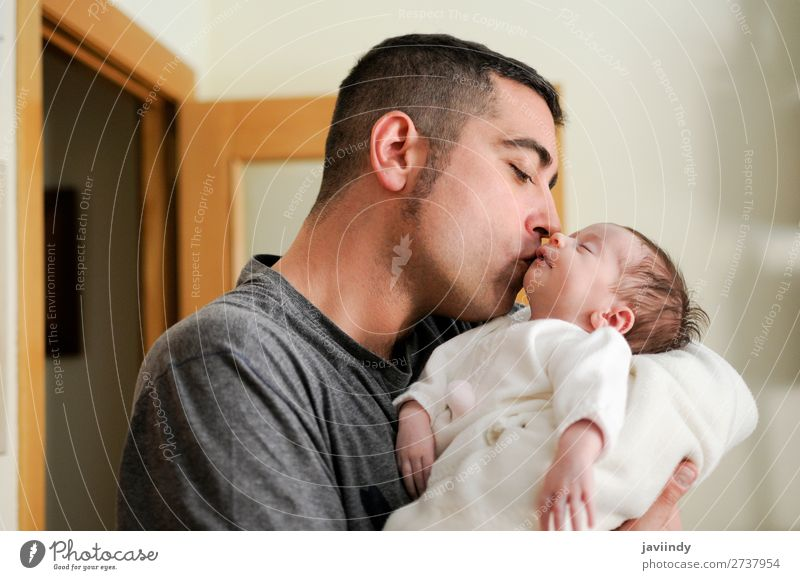 Father kissing his newborn baby girl. Happy Child Human being Masculine Baby Man Adults Parents Family & Relations Infancy Youth (Young adults) 2 0 - 12 months