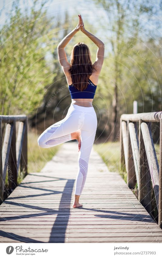 Young beautiful woman doing yoga in nature Lifestyle Happy Beautiful Body Relaxation Meditation Summer Sports Yoga Human being Feminine Woman Adults