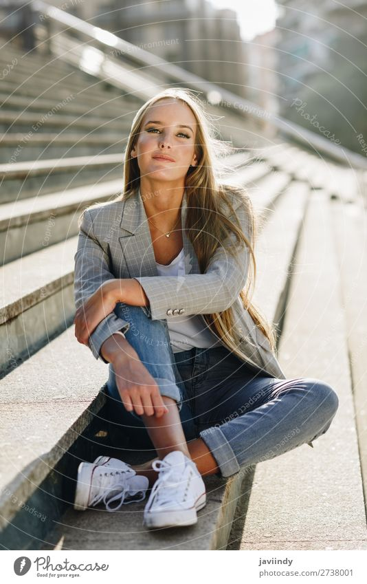 Beautiful young blonde woman sitting on urban steps. Woman Human being Youth (Young adults) Young woman White 18 - 30 years Street Lifestyle Adults Autumn