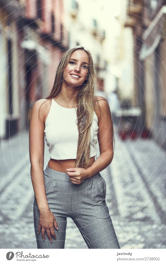 Young blonde woman, straight hairstyle, in urban background. Lifestyle Elegant Style Happy Beautiful Hair and hairstyles Summer Human being Feminine Young woman