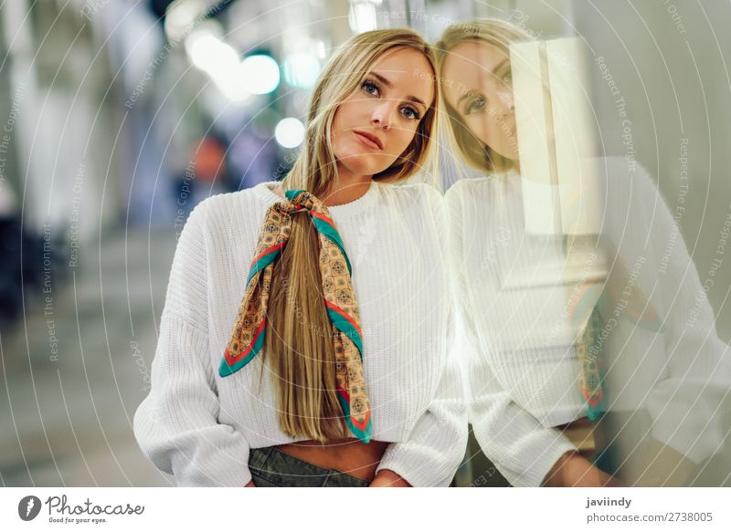 Blonde girl with defocused urban city lights at night Lifestyle Shopping Style Happy Beautiful Hair and hairstyles Winter Human being Feminine Young woman