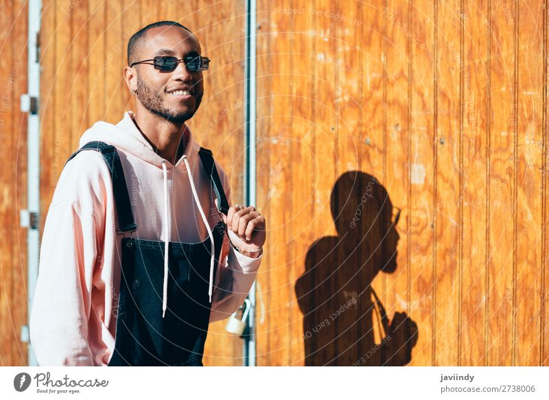 Young black man wearing casual clothes and sunglasses outdoors Human being Youth (Young adults) Man Beautiful Young man Black 18 - 30 years Street Lifestyle