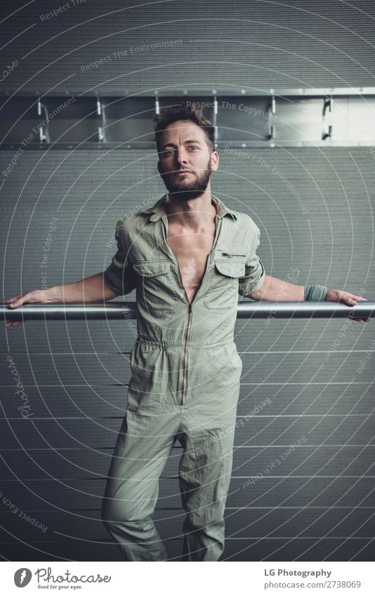 Portrait of a man in a jumpsuit Beautiful Body Calm Masculine Homosexual Man Adults Building Fashion Beard Metal Simple Eroticism Modern Gray White hair Khaki