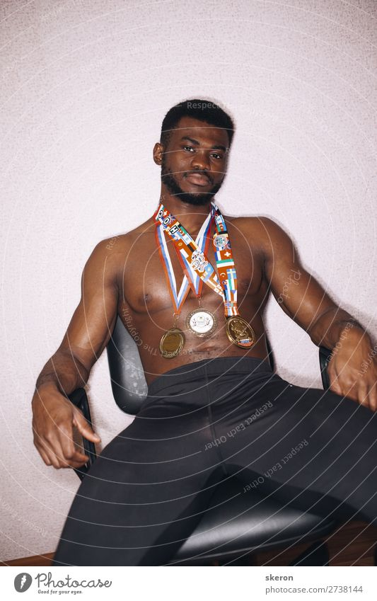 African athlete with medals on his chest Lifestyle Leisure and hobbies Sports Fitness Sports Training Track and Field Sportsperson Award ceremony Success