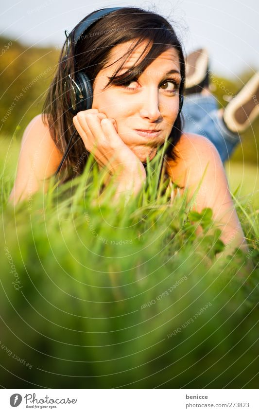 Music & Grass Woman Human being Summer Meadow Lie Listening Headphones MP3 player CD player Walkman Joy Bird's-eye view Sun Sunbeam Laughter Smiling Relaxation