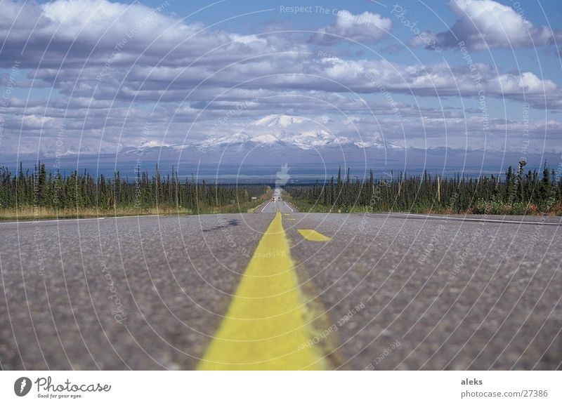Road to the mountain Clouds Yellow Stripe Asphalt Street Mountain Sky Blue Clouds in the sky Central perspective Median strip Lane markings Landscape