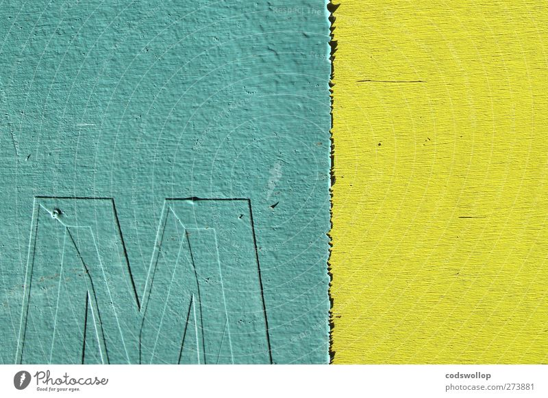 """""""em,"""" op. cit. Facade Wood Sign Characters Yellow Green M Minimalistic Colour photo Exterior shot Deserted Copy Space left Copy Space top Neutral Background"""