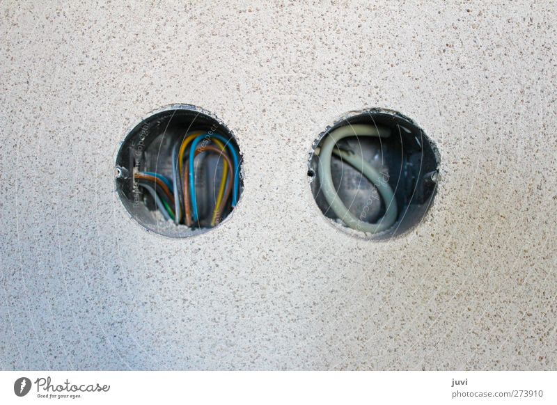 2 x round Cable Technology Wall (barrier) Wall (building) Concrete Blue Yellow Gray Discover Round Hollow Plaster Colour photo Subdued colour Interior shot