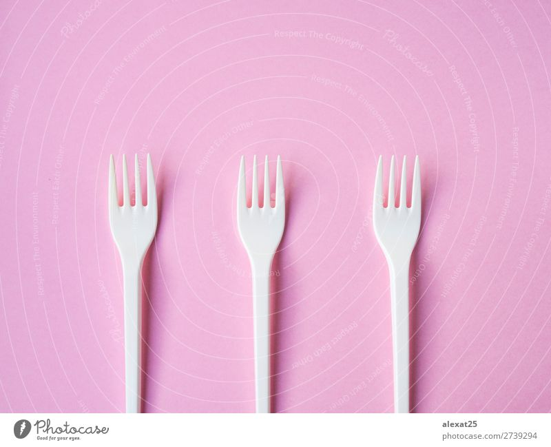 Plastic fork pattern on pink background Cutlery Fork Design Table Kitchen Accessory Bright White Colour colorful copy eat equipment forks Horizontal isolated