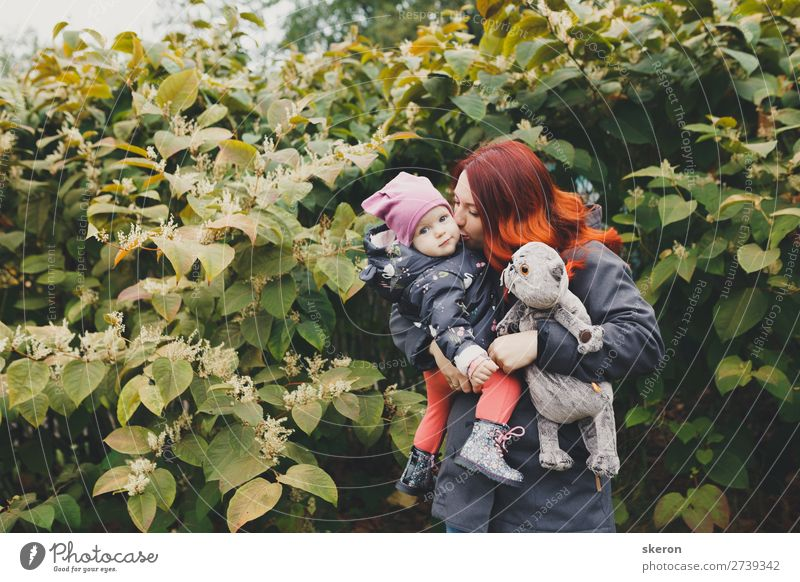 happy family: mom and daughter on a walk Lifestyle Leisure and hobbies Adventure Going out Parenting Education Kindergarten Child Human being Feminine Baby