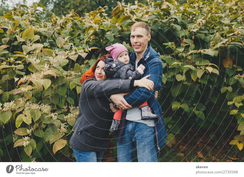 happy family on a walk with a small child Lifestyle Leisure and hobbies Vacation & Travel City trip Human being Masculine Feminine Child Baby Girl Parents