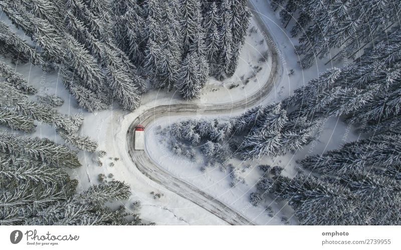 Aerial landscape with meandering snowy winter mountain road with a moving truck Winter Snow Mountain Nature Landscape Tree Forest Road traffic Vehicle Truck