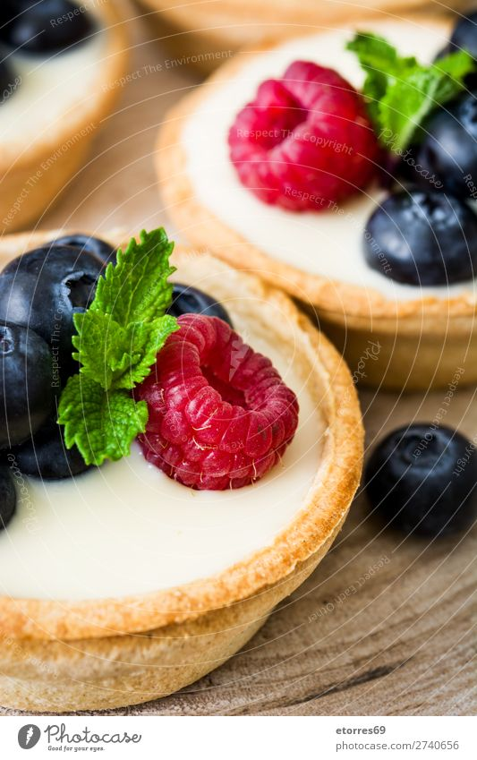 Delicious tartlets with berries Tartlet Raspberry Blueberry Fruit Dessert Food Food photograph Healthy Eating Cream custard Snack glazed Baked goods Home-made