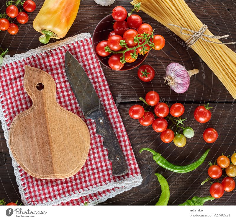 cutting board with a knife and fresh red cherry tomatoes Vegetable Nutrition Lunch Vegetarian diet Knives Table Kitchen Wood Line Eating Fresh Large Long Above