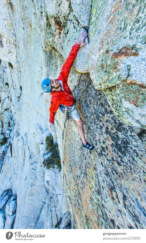 Rock climber gripping. Human being Man Adults Life Power Masculine Success Adventure Rope Climbing Trust Jacket Athletic Brave Balance