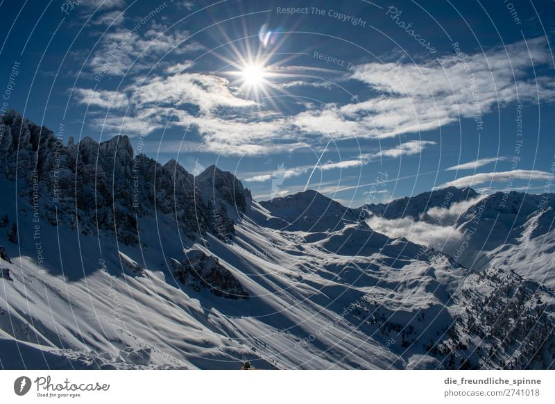 Mountain panorama in winter mountains Alps outlook Snow Sun Glare effect Sky Winter Clouds Blue Rock Ice Peak Panorama (View) Nature Landscape Exterior shot