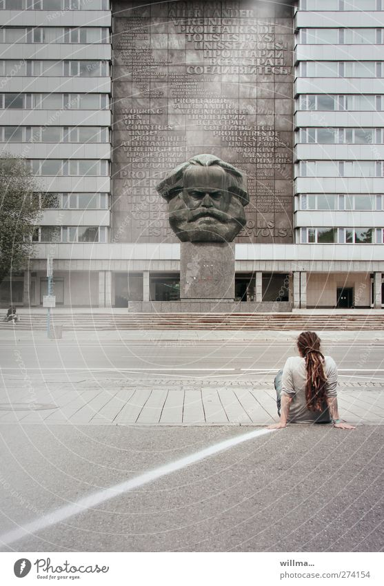 man with rastas sitting in front of marx monument on the street - confrontation Youth (Young adults) Sculpture Tourist Attraction Landmark Monument Dreadlocks