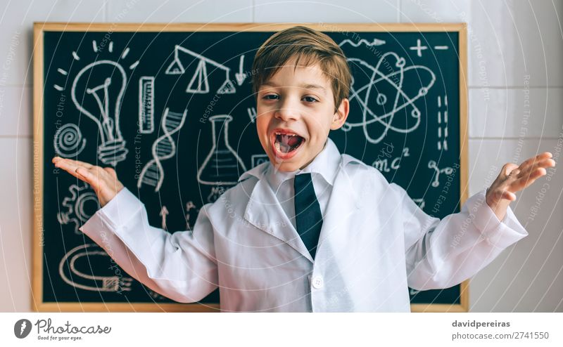 Child dressed as a scientist and chalkboard Happy Science & Research Blackboard Laboratory Human being Boy (child) Man Adults Tie Blonde Authentic Funny Smart