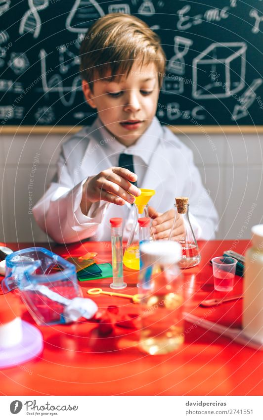 Boy playing with chemistry game Playing Science & Research Child School Blackboard Laboratory Human being Boy (child) Man Adults Tie Think Smart Interest