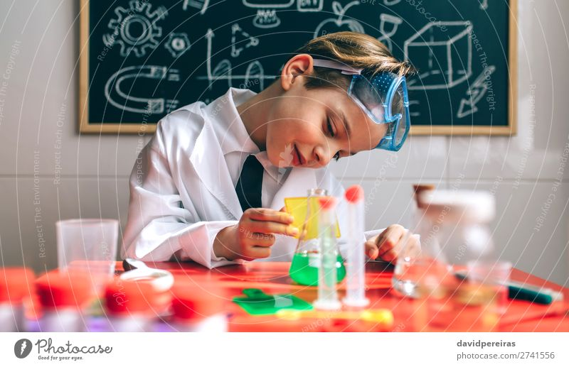 Boy playing with chemistry game Playing Science & Research Child School Blackboard Laboratory Human being Boy (child) Man Adults Think Smart Interest experiment