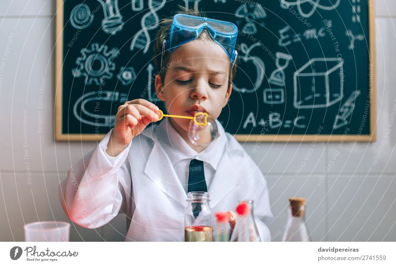 Boy playing with chemistry game blowing bubbles Bottle Playing Science & Research Child School Blackboard Laboratory Human being Boy (child) Man Adults Tie Cute