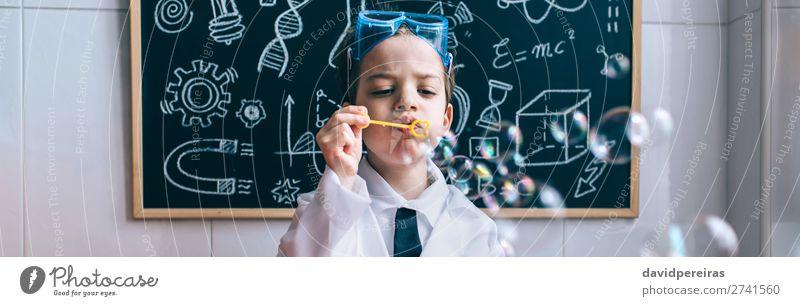 Kid doing soap bubbles against of drawn blackboard Bottle Joy Happy Playing Table Science & Research Child School Classroom Blackboard Laboratory Internet