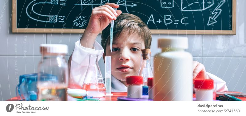 Kid playing with chemical liquids over table Bottle Happy Playing Table Science & Research Child Classroom Blackboard Laboratory Internet Human being