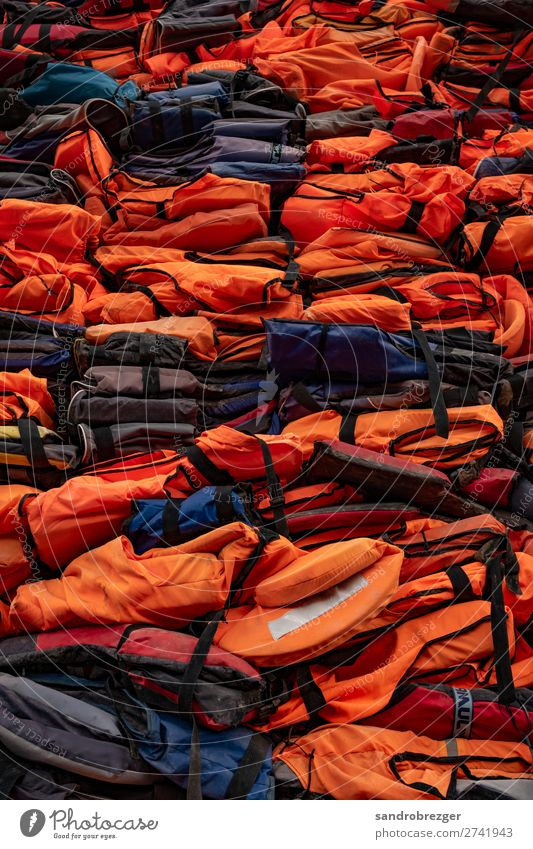 Stacking life jackets Life jacket refugee Escape Water Panic Refugee Boating trip Fear Walking Human being Flee Drown Escape route Loneliness Dangerous Tunnel