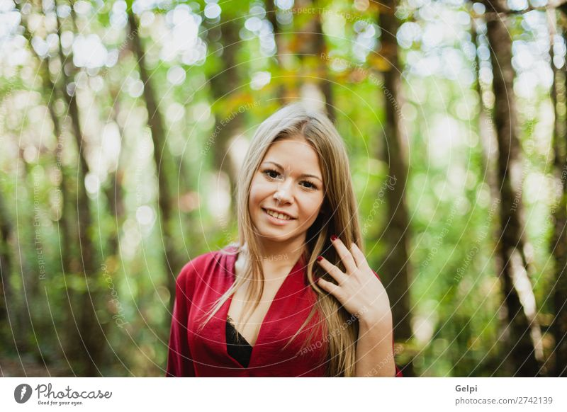 Beautiful woman in a beautiful forest Lifestyle Happy Face Freedom Human being Woman Adults Nature Autumn Wind Tree Park Forest Fashion Blonde Smiling Eroticism