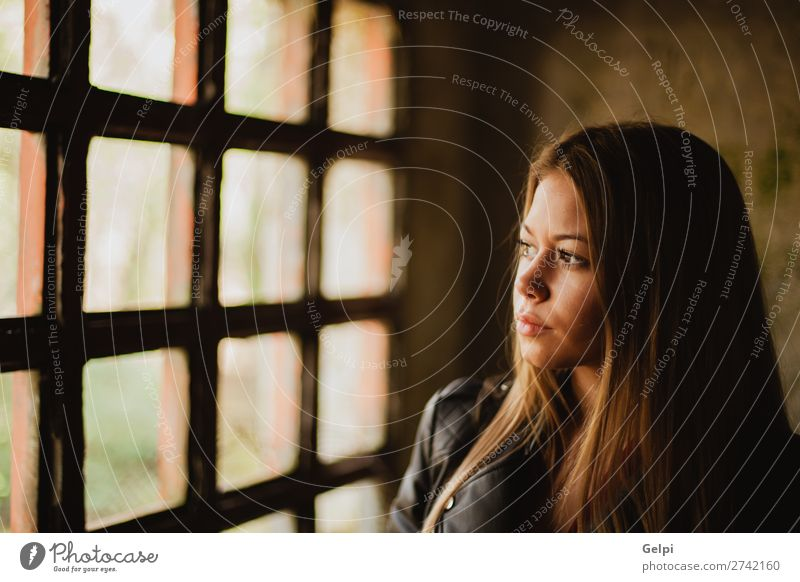 Pensive blonde woman next to a windows Lifestyle Beautiful Face Leisure and hobbies Flat (apartment) House (Residential Structure) Human being Woman Adults