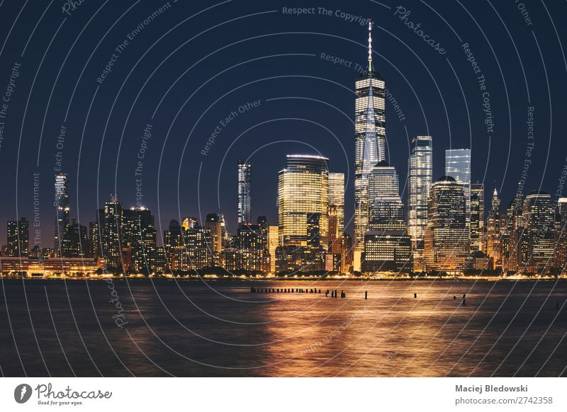 New York City business district skyline at night. Shopping Luxury Elegant Sightseeing City trip Living or residing Workplace Office Economy Business Success Sky