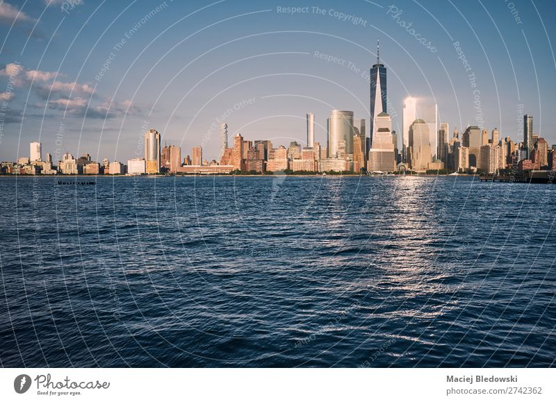 Manhattan skyline at sunset, USA. Luxury Elegant Design Sightseeing City trip Cruise Summer Living or residing Landscape Sky River Skyline High-rise Building